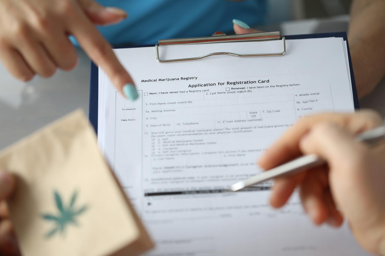 patient filling application for registration card